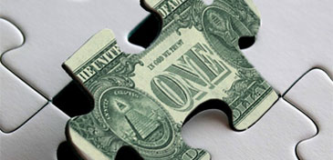 dollar bill jigsaw piece
